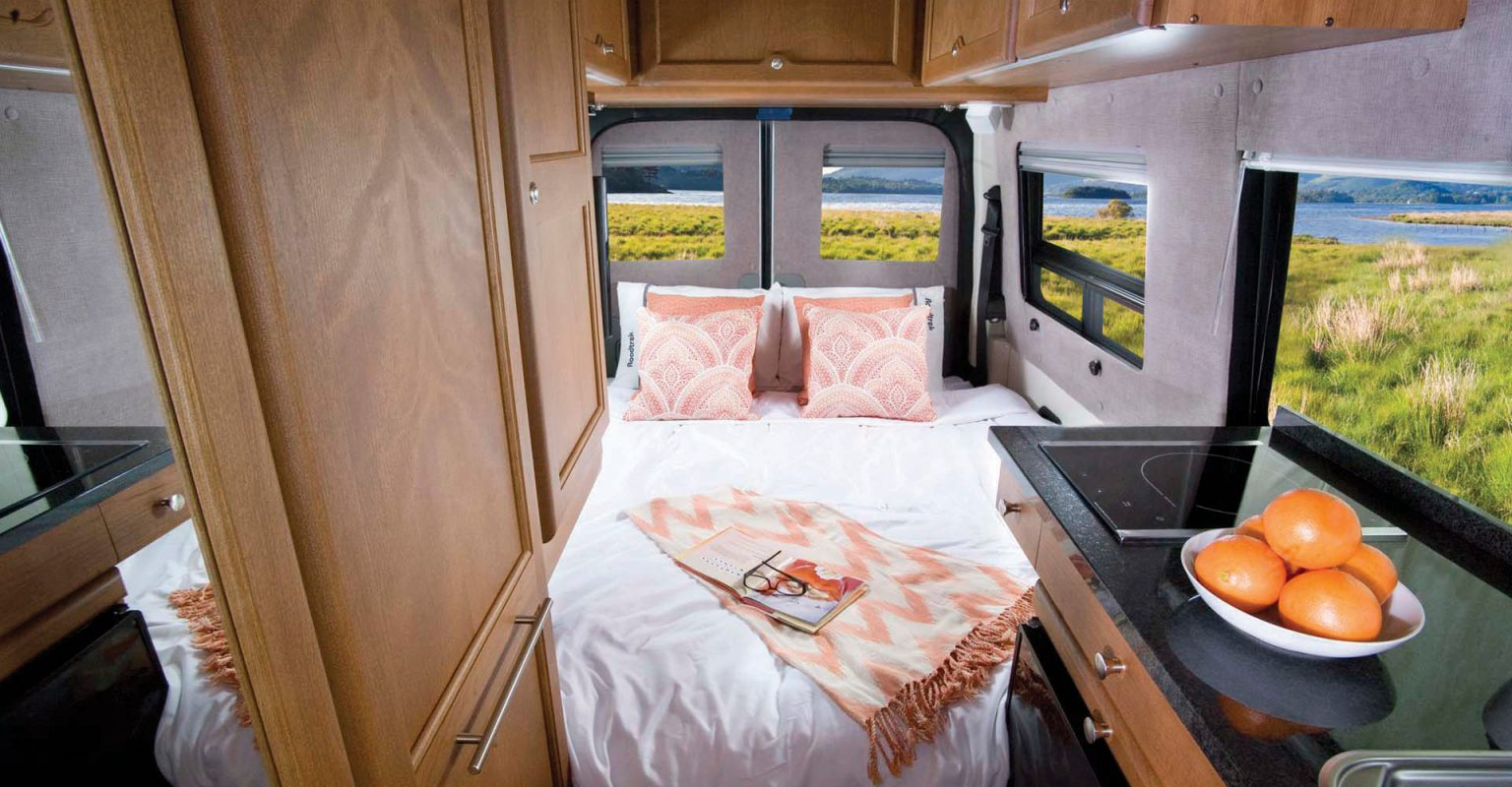 roadtrek e-trek mercedes sprinter luxury camper van: rear king sized  bed